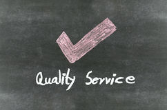 Checkmark symbol and word Stock Image