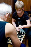 Checkmate. Grandfather and his grandson playing chess Stock Photos