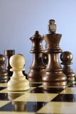 Checkmate. A game of chess comes to an end. The black king is checkmated, and white is victorious Stock Photo