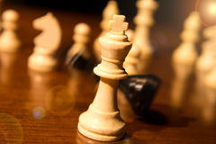 Checkmate. A falling chess king stock photography