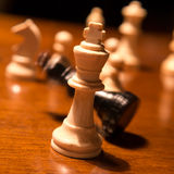 Checkmate. Falling chess king table royalty free stock photography