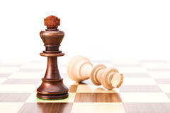 Checkmate black defeats white king. On chessboard Stock Image