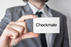 Checkmate. Businessman showing business card Stock Images