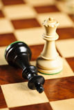 Checkmate in chess. Closeup of checkmate on king by queen winning in chess game stock image