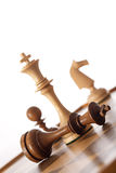 Checkmate chess game. Chess game - white king standing over black king - checkmate royalty free stock images