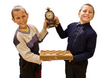 Checkmate concept. Two boys holding a checkmate table and a clock royalty free stock photography