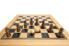 Checkmate. Falling white king has threatened with capture by masses of pawns on wooden chess board, checkmate concept in chess game stock image