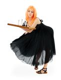 Checkmate. Lovely girl with chess over white background stock images