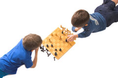 Checkmate, my friend. Two children playing chess, pieces in checkmate position, isolated over white royalty free stock images