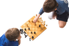 Checkmate, my friend. Two children playing chess, pieces in checkmate position, isolated over white royalty free stock photo