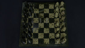 Checkmate. Start Of A Chess Game,the Figures Are Lined Up And A Person Makes The First Move. Hand moving a knight chess Royalty Free Stock Photos