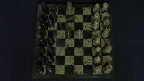 Checkmate. Start Of A Chess Game,the Figures Are Lined Up And A Person Makes The First Move. Hand moving a knight chess Stock Photography