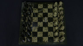 Checkmate. Start Of A Chess Game,the Figures Are Lined Up And A Person Makes The First Move. Hand moving a knight chess Stock Image