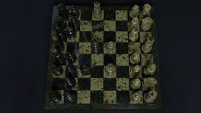 Checkmate. Start Of A Chess Game,the Figures Are Lined Up And A Person Makes The First Move. Hand moving a knight chess Stock Images