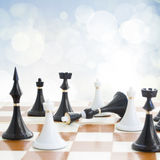 Checkmate white defeats black  king. Checkmate white knight  defeats black king on blue background Stock Images
