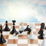 Checkmate white defeats black  king. Checkmate white knight  defeats black king on sky  blue background Royalty Free Stock Photos