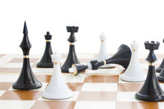 Checkmate white defeats black  quinn. Checkmate white knight  defeats black quinn close up Stock Photo