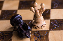 Checkmate. By white queen to black king stock image