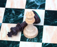 Checkmate. Wooden chess pieces on chessboard Stock Images