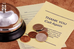 Checkout. Bell With Receipt and Change. Checkout Concept royalty free stock photo