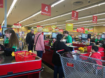 Checkout Line at Grocery Outlet Store. SPRINGFIELD, OR - OCTOBER 22, 2015: Shoppers in line at checkout stands at Grocery Outlet, a bargain liquidation market Royalty Free Stock Photography