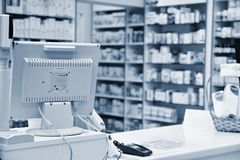 Checkout the pharmacy. Interior pharmacies and blurred background. Computer - shopping royalty free stock photos