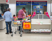 Checkout in a superstore. People waiting to pay for their groceries at a supermarket checkout. This checkout is in the sainsbury shop in Bedford, England Stock Images