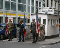 Checkpoint Charlie. The former border crossing point between West and East Berlin. Nowadays a tourist attraction Stock Photo