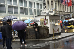 Checkpoint Charlie  In Berlin Germany in the pouring rain Royalty Free Stock Photo