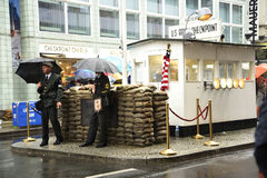 Checkpoint Charlie  In Berlin Germany in the pouring rain Royalty Free Stock Photos