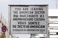 Checkpoint Charlie sign. Historical sign at the former Checkpoint Charlie border crossing in Berlin, German royalty free stock photography