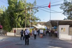 Checkpoint at the seperated Cyprus capital Nicosia. Nicosia, Cyprus, November 08, 2017: Local people and tourist are passing the border passport control royalty free stock image
