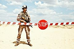 Checkpoint. US marine with assault rifle near the barrier at a checkpoint royalty free stock image
