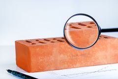 Checks the quality of the brick in the laboratory. royalty free stock image