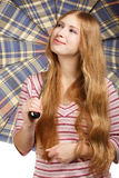 Checks and stripes. Beautiful young smiling woman with chequered umbrella isolated on white background Stock Photos