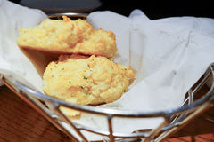 Cheddar Bay biscuit. Close up of Cheddar Bay biscuit in a basket Royalty Free Stock Images