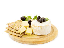 Cheddar and Brie cheese with crackers. Healthy snacks - Brie and cheddar cheese with organic crackers. Isolated on white stock images