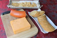 Cheddar cheese block background. The party food appetizers are laid out stock photography