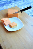 Cheddar cheese block and slices vertical Royalty Free Stock Image
