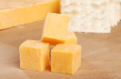 Cheddar Cheese And Crackers Focus On Top Cube Royalty Free Stock Photography