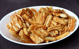 Cheddar Cheese crackers in a white bowl Royalty Free Stock Image
