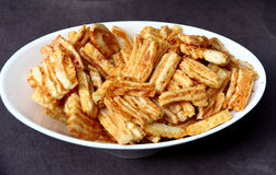 Cheddar Cheese crackers in a white bowl Stock Photography
