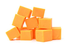 Cheddar cheese. Cubes of cheddar cheese isolated on white stock photo