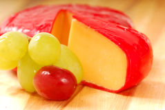 Cheddar cheese and grapes Royalty Free Stock Image