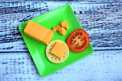 Cheddar Cheese with Tomato slice Stock Photography