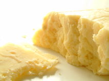 Cheddar cheese on white background Stock Photos