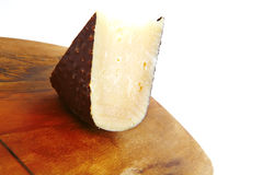 Cheddar cheese on wooden board Royalty Free Stock Image