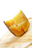 Cheddar cheese on wooden board Royalty Free Stock Photo