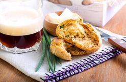 Cheddar & chive beer dampers. And glass of coffee stock photography
