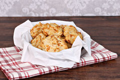 Cheddar, garlic biscuits in a napkin lined basket. Selective foc Royalty Free Stock Photo